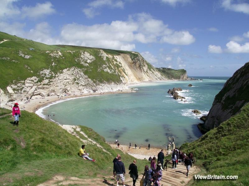 path-down-to-beach-east-of-Durdle-door-limestone-arch-Lulworth-Dorset-England