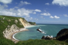Beach-east-of-Durdle-Door-Limestone-arch-Lulworth-Dorset-England-min