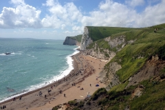Beach-near-Durdle-Door-on-a-sunny-day-people-sunbathing-Dorset-England-min
