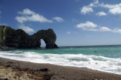 Durdle-Door-Beach-west-of-limestone-arch-Dorset-England-min
