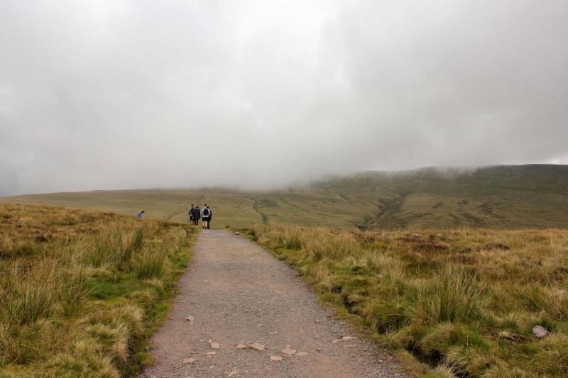 hikers-climbing-mountain-corn-du-pen-y-fan-brecon-beacons